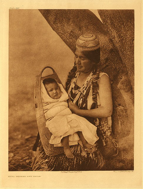 Hupa mother and child by Edward S. Curtis. 1923.