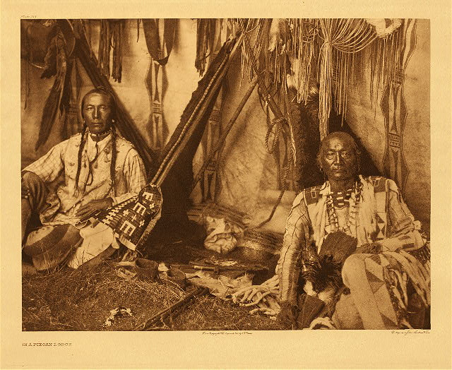 In a Piegan lodge by Edward S. Curtis. 1910.