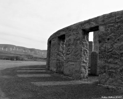 Stonehenge Memorial near Maryhill,WA with wind turbines